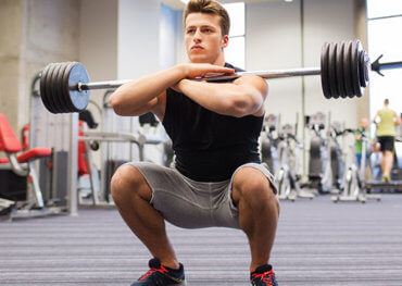guy performing front squat workout